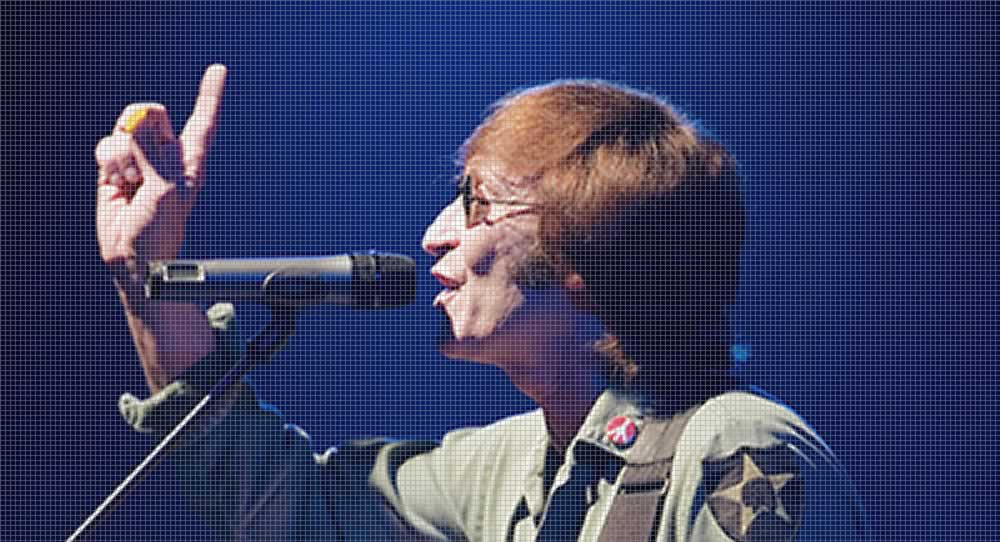 Gary Gibson John Lennon tribute act on stage